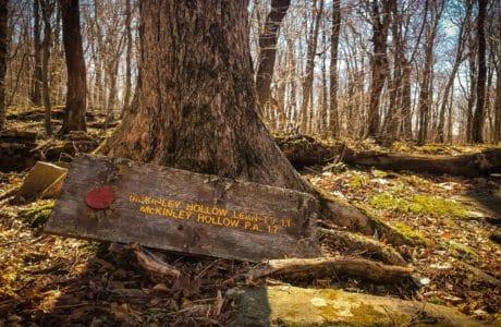 old broken hiking trail sign