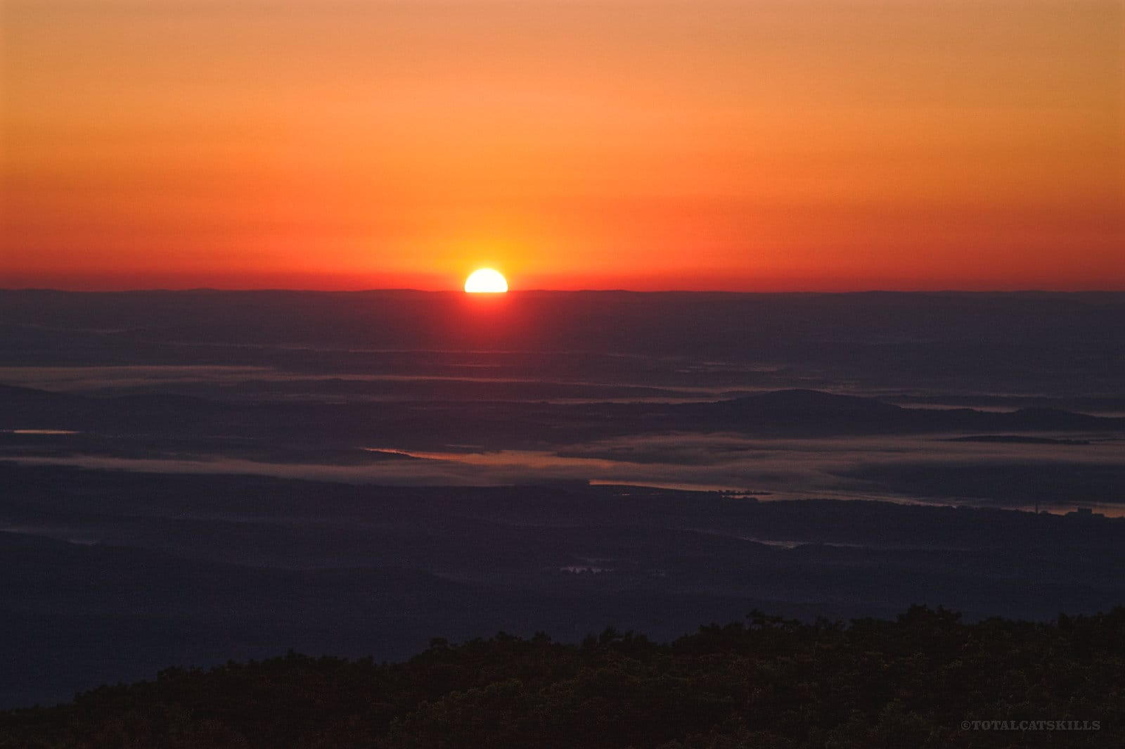 sun rising on the horizon
