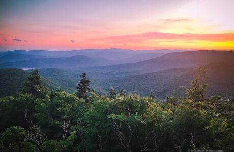 sunset over mountain peaks